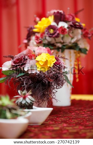 the Boquet of flowers on arranged table - stock photo