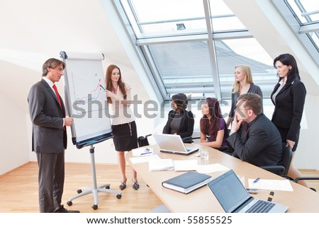 the boss is introducing the new office employee - stock photo