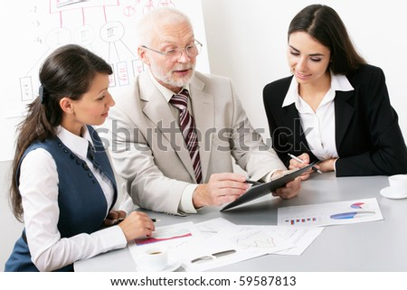 The boss trains the colleagues - stock photo