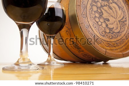 The bottle of red wine and glass and wine-cask - stock photo