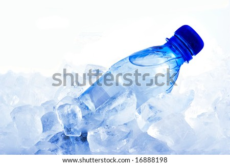 The bottle of water in ice - stock photo