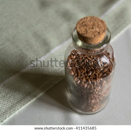 the bottle with flax seeds