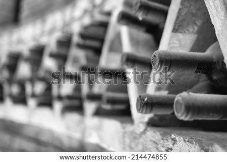 The bottles of wine aged in the dark cellar - stock photo
