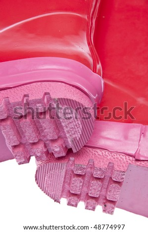The bottom detail of pink rain boots isolated on white.