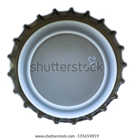 The bottom (inside) part of a metal cap used for glass soda bottles. Isolated on white background. - stock photo