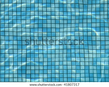 The bottom of a pool view from above through the water. - stock photo