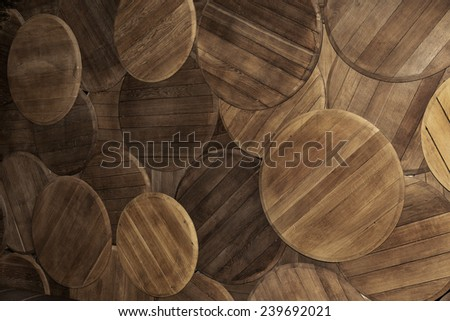 the bottom of the oak barrels in the form of the original wall background in perspective - stock photo