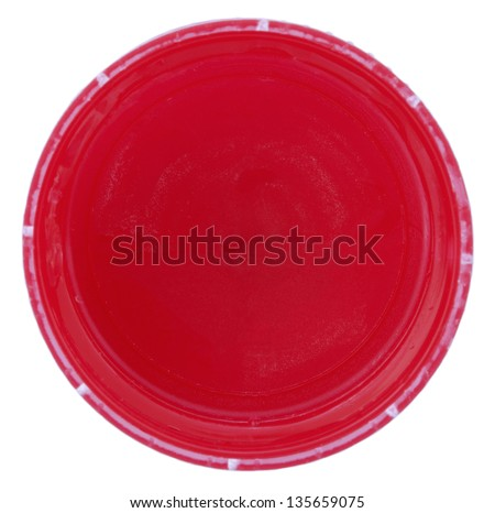 The bottom side of a red plastic bottle cap isolated on white background. - stock photo