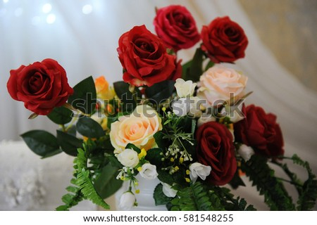 The bouquet of red and pink roses close-up