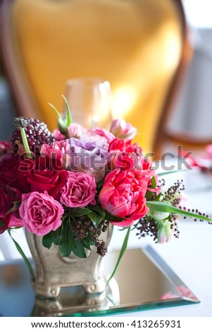 The bouquet of red and pink roses, peonies with grapes and pomegranates in the Dutch style - stock photo