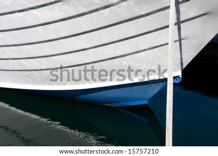 The bow and Tie-Rope of a small boat, berthed in Nelson Bay, New South Wales, Australia - stock photo