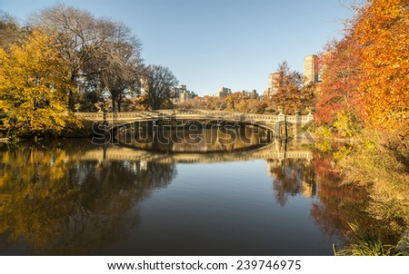 The Bow Bridge  is a cast iron bridge located in Central Park, New York City, autumn in early morning - stock photo