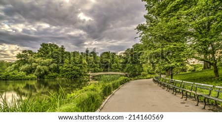 The Bow Bridge  is a cast iron bridge located in Central Park, New York City on storm couldy day - stock photo