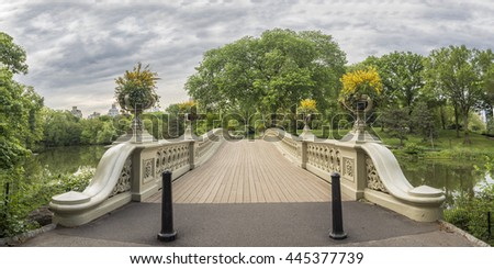 The Bow Bridge located in Central Park, New York City, crossing over The Lake in summer early morning - stock photo