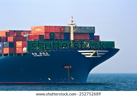 The bow of a huge container ship Hyundai Faith anchored. Nakhodka Bay. East (Japan) Sea. 19.04.2014 - stock photo