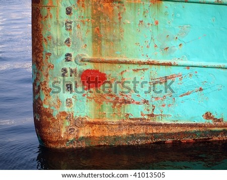 The bow of a ship showing heavy corrosion - stock photo