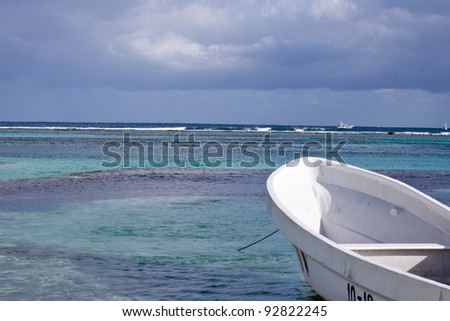 The bow of a small boat with the water of Costa Maya Mexico in the background - stock photo