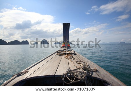 The bow of Thai wooden boat into the sea