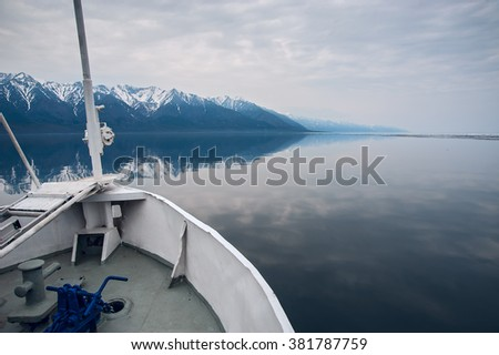 the bow of the ship on the background of snowy mountains