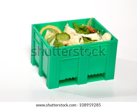 The box made ??of green plastic for food waste - stock photo
