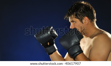 The boxer. The young man in boxing gloves - stock photo