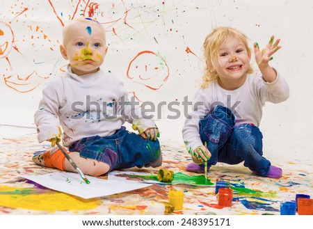 The boy and the girl draw - stock photo