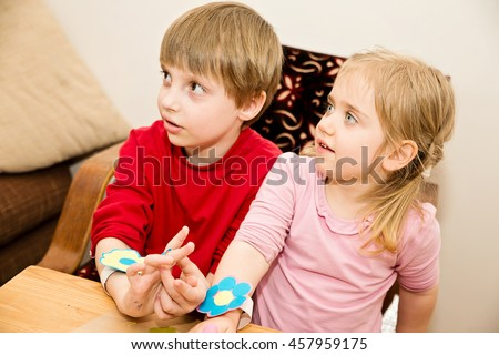 The boy and the girl have beautiful flower bracelets