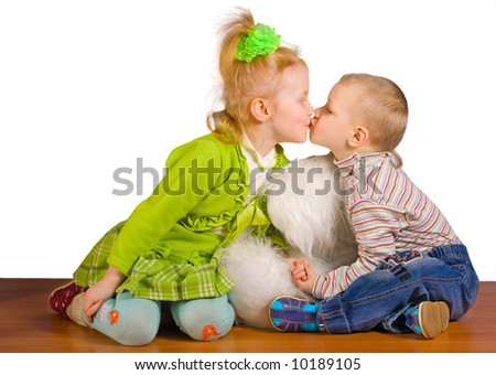 The boy and the girl kiss each other