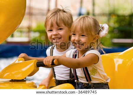 The boy and the little girl on attraction - stock photo