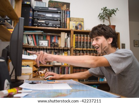 The boy at a computer in the room