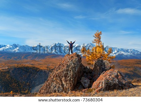The boy at peak of a rock against glaciers - stock photo