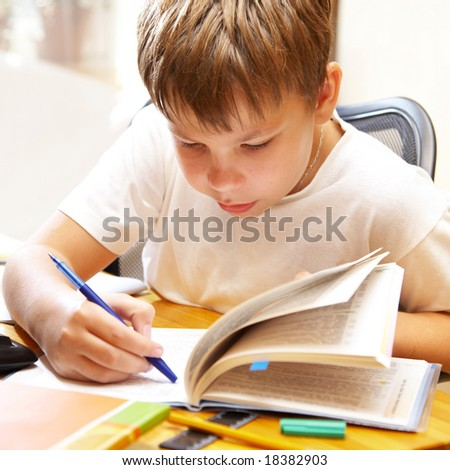 The boy behind a desk... - stock photo