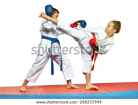 The boy blocks blow of the girl-legged in the head - stock photo