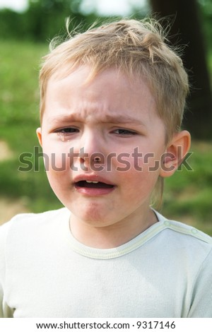 The boy cries. Probably did not give some ice-cream - stock photo