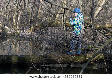 the boy crossed the river on a log