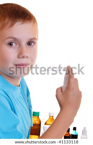 The boy does inhalation  on a white background