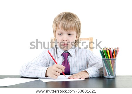 The boy draws - stock photo