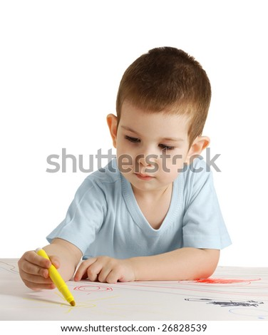 The boy draws color felt-tip pens on a white sheet of a paper