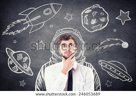 The boy dreams of cosmos in the imagination - stock photo