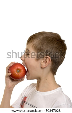 The boy eats an apple isolated on white background - stock photo