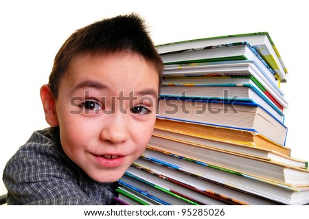 The boy has clasped hands a pile of books. Isolated on white - stock photo