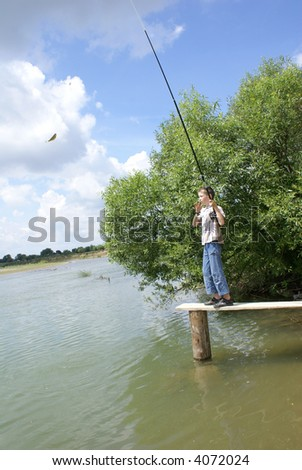 The boy has fished - stock photo