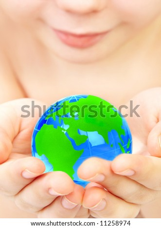The boy holds globe in hands - stock photo