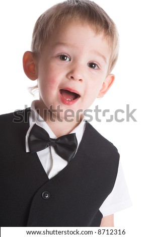 The boy in a black suit on a white background