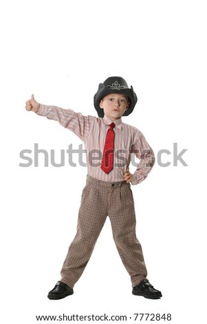 The boy in a cowboy's hat and a red tie - stock photo