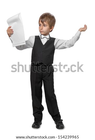 The boy  in a jacket with a bow tie,  reads the leaf notebook. Isolate on white background - stock photo