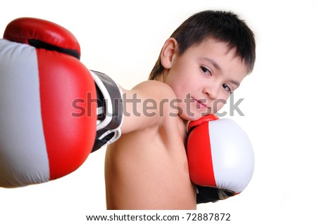 The boy in boxing gloves - stock photo