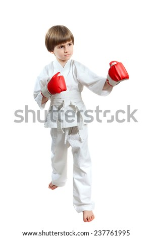 the boy in kimono standing in a combat stance - stock photo
