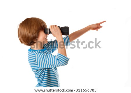The boy in sailor's striped vest is looking through binocular and points way - stock photo