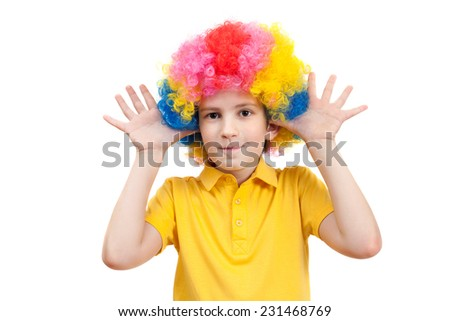 the boy in the carnival clown wig - stock photo